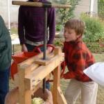 Fall-2012-Cider-Fest-boy-at-the-crank